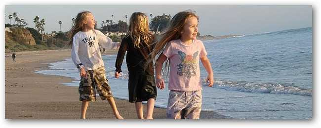 three-girls-playing-at-beach