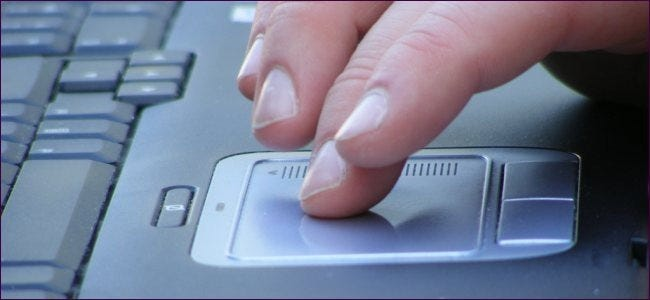 fingers on laptop touchpad