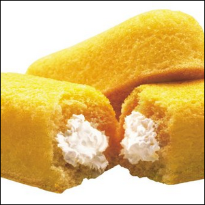 Twinkie snack cakes, with one broken open to reveal the cream filling