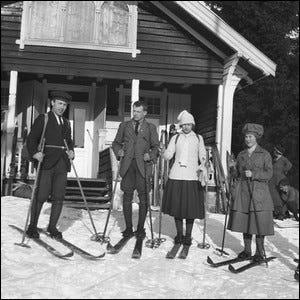 Friends preparing to go skiing in 1920s Norway