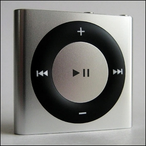 A silver iPod Shuffle with the pause symbol clearly seen in middle of the center control button