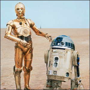 C-3P0 and R2-D2 standing in the desert