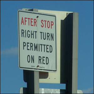 """Example of a right turn sign reading """"After stop, right turn permitted on red"""""""