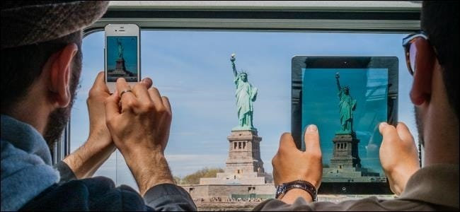taking-photos-with-tablet-vs-smartphone