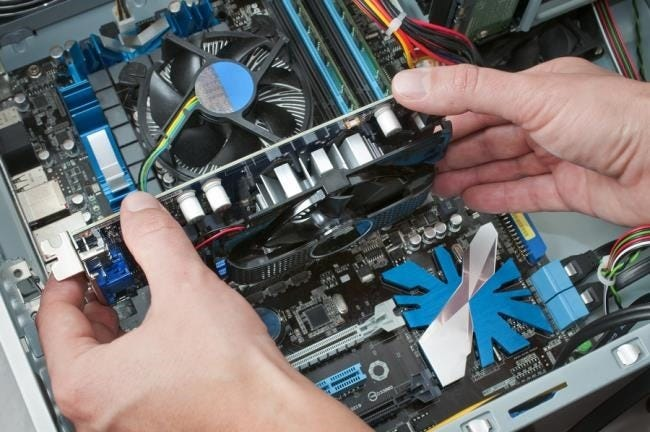 inserting-graphics-card-into-motherboard-slot