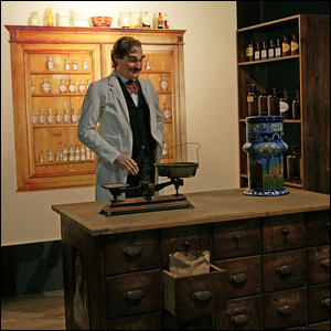 A painting of the inventor of Pepsi in his pharmacy.