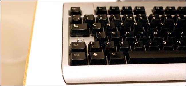 caps-lock-key-pried-off-keyboard