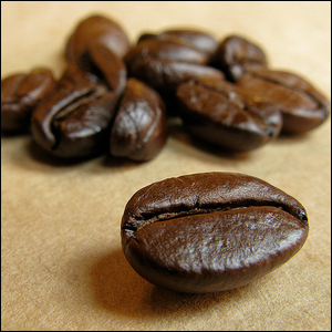 Close up view of coffee beans on brown paper