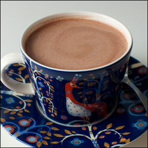 A cup of chocolate milk.
