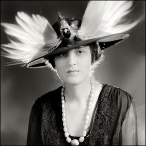 Photograph of an early 20th century woman wearing an elaborate bird hat.