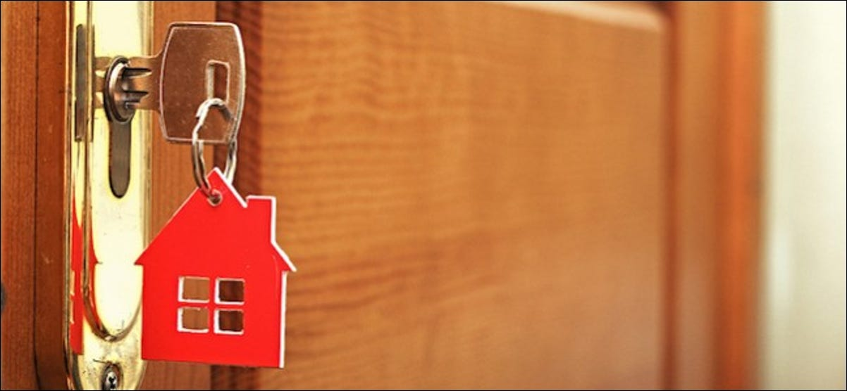 A key in a lock with house icon on i
