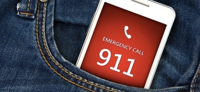 Mobile Phone In Pocket With Emergency Number 911. Focus On Screen