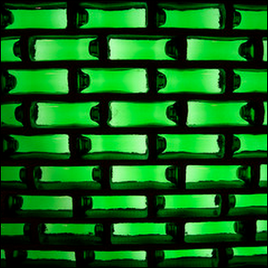 A wall made from stacked beer bottles.