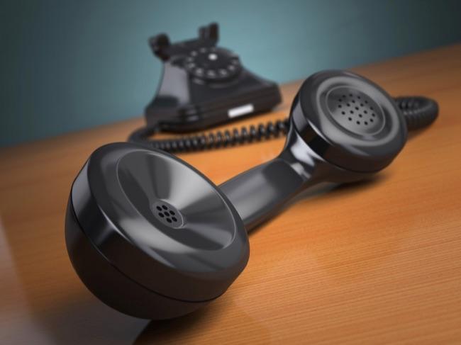 Vintage phone on green background. Hotline support concept. 3d