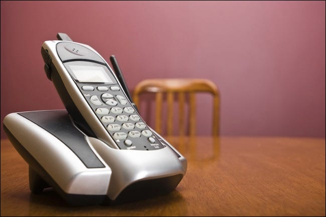 Cordless Phone On A Table With Chair
