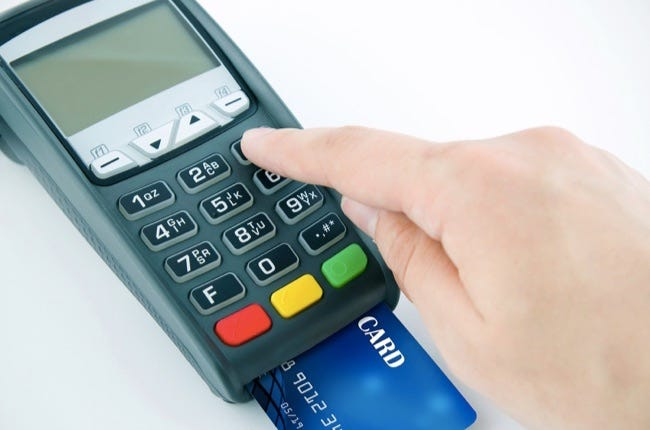 Man using payment terminal keypad enter personal identyfication number