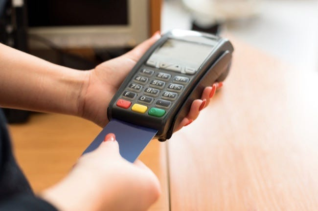 Woman pay by credit card in shop ** Note: Soft Focus at 100%, best at smaller sizes