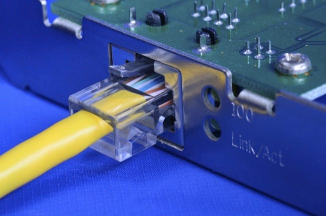 Ethernet cable on the network card concept of communication and internet