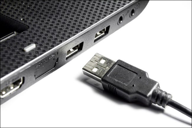 Laptop With Usb Connectors And Usb Cable On A White Background