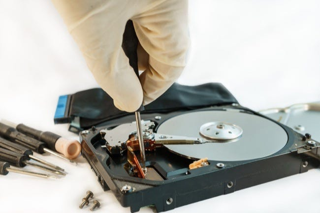Screw Hard Disk Drive To Repair For Recovery Information