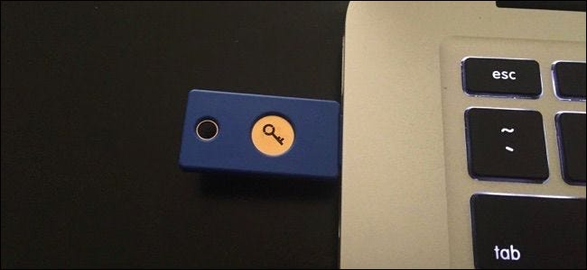 A Yubikey physical USB security key plugged into the USB port on a laptop.