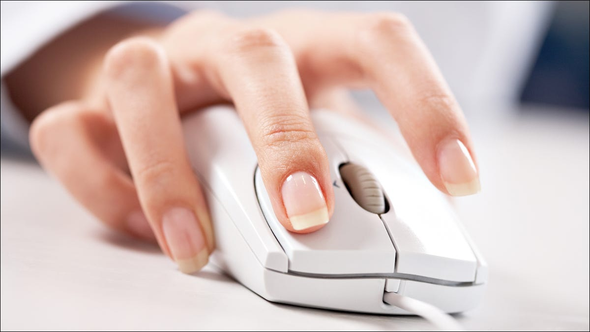 Person using a computer mouse with a scroll wheel