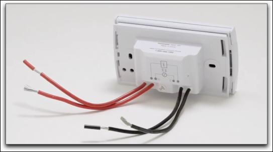 A typical high-voltage thermostat with 2-4 black and red wires.