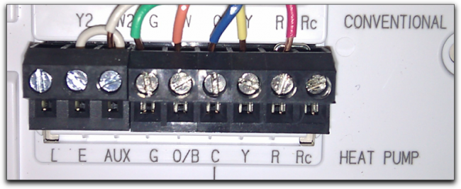 A typical low-voltage thermostat, with multiple small wires in different colors.
