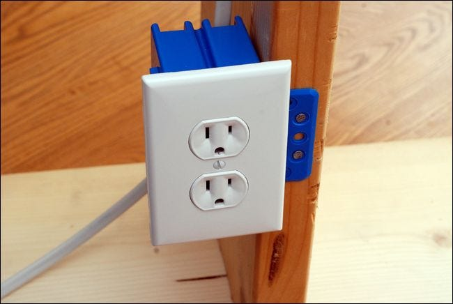 for the purposes of this article we constructed a mock (but operational) electrical  wiring setup using some scrap wood and basic electrical components,