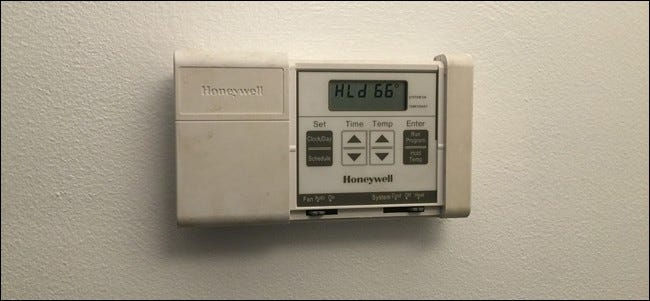 how to change battery in old honeywell thermostat