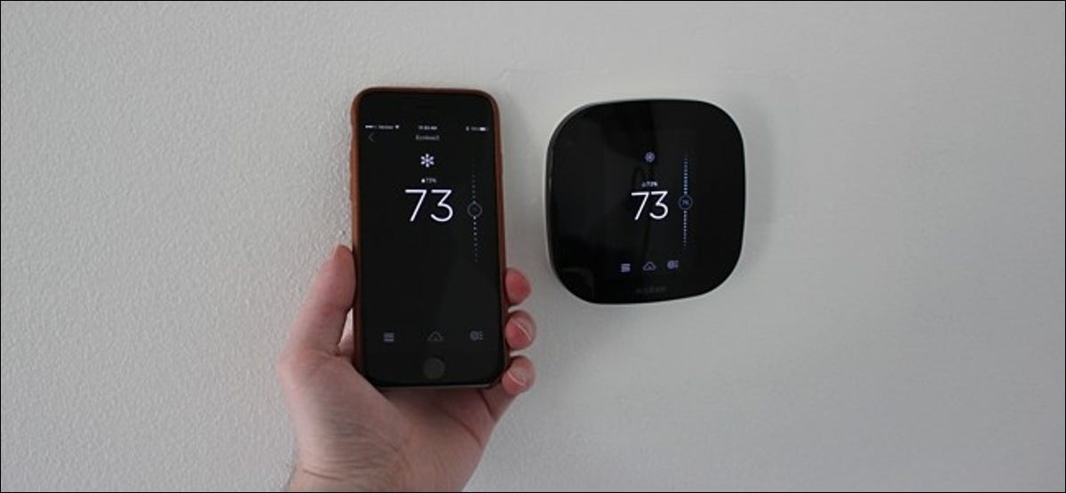 Smartphone controlling temperature on a smart thermostat