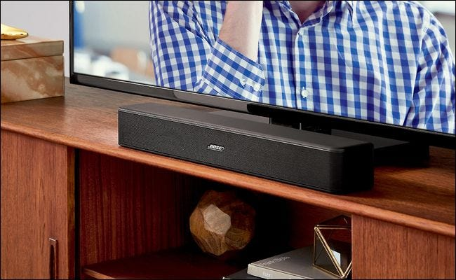 Sound Bars Are Typically Placed In Front Of The Tv On Same Stand Like Bose Solo 5 Seen Above Or Wall Mounted Below Set