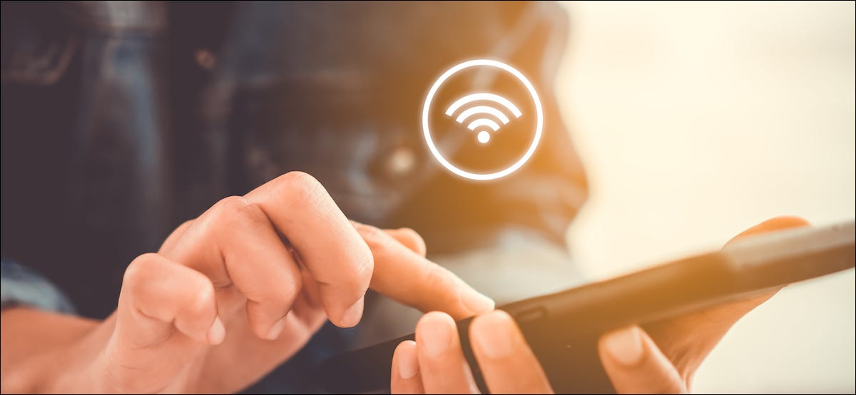 Wi-Fi symbol hovering over a smartphone in someone's hand