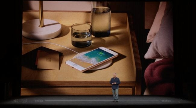 An iPhone 8 with a wireless charger, as shown during Apple's announcement.