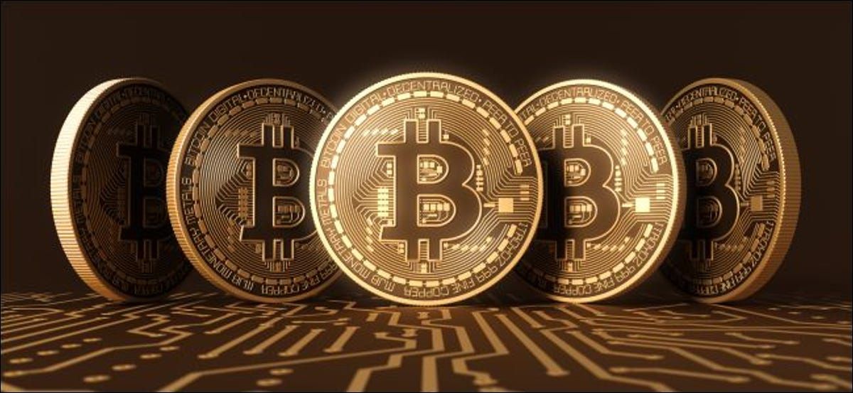 A 3D rendering of coins featuring a Bitcoin logo.