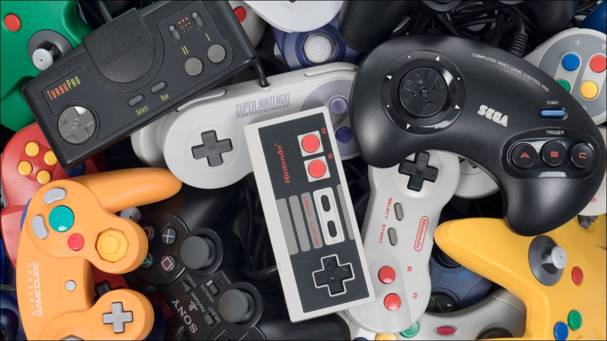 Classic video game controllers in a pile