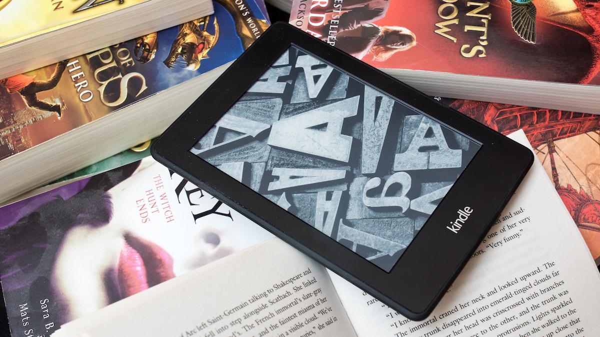 Amazon Kindle on a pile of books