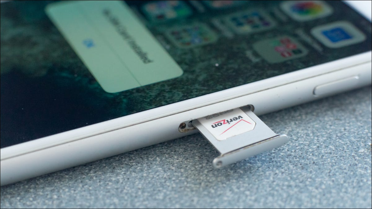 Verizon SIM card being removed from an Apple iPhone