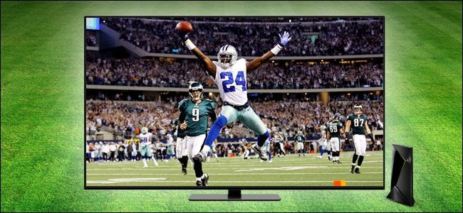 Football player jumping mid-game on TV.