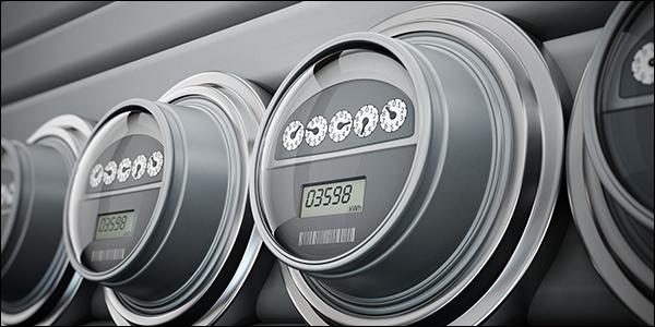 a row of ominous looking smart meters