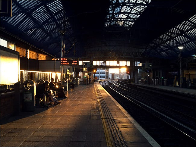 interior of train station with sun setting in background