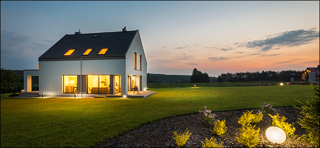 Modern rural home with outdoor lighting at night