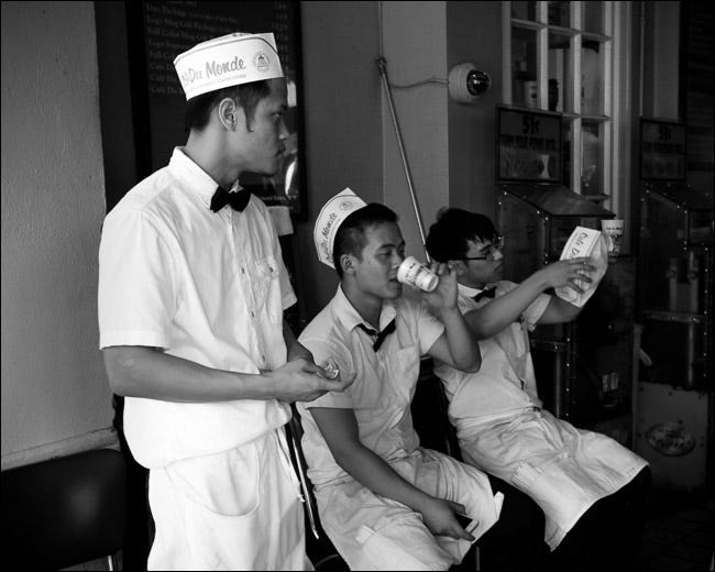 three restaurant workers chatting outside during a break