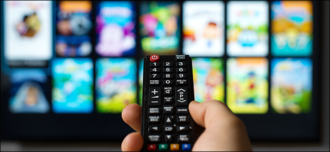 Hand pointing a remote at a smart TV