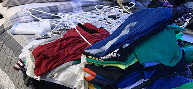 Decluttering a pile of old clothes