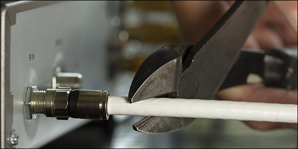 Hand cutting coaxel cable with a pair of shears