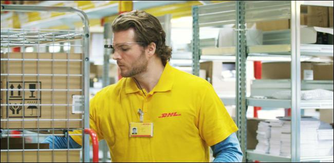 man stocking warehouse shelves and wearing Google Glass