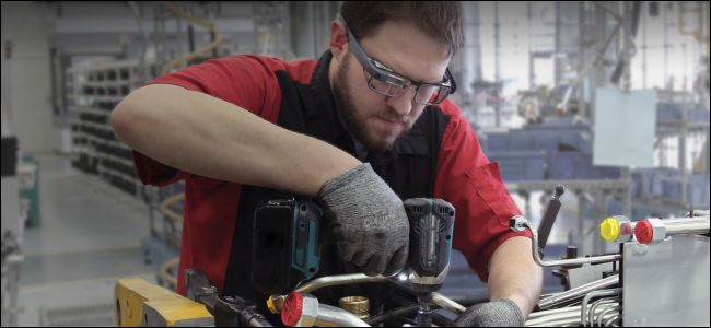 man using drill and wearing Google Glass