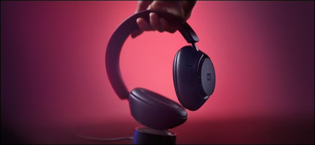 Dolby Dimension Headphones on charging base.
