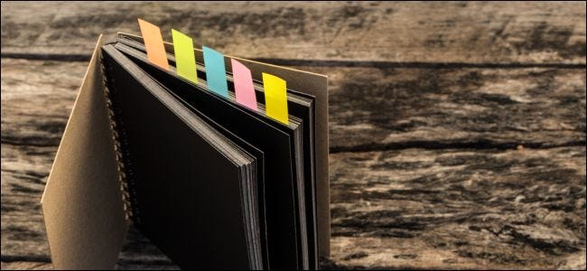 Colorful bookmarks for documents with notebook